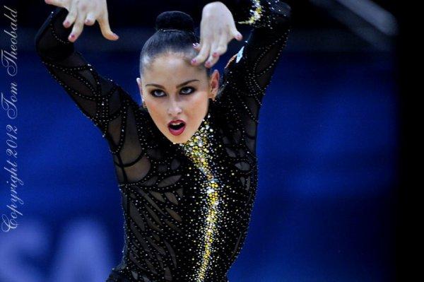Vos photos favorites de gymnastes ! 3131444728_1_6_0Zh6aRSl